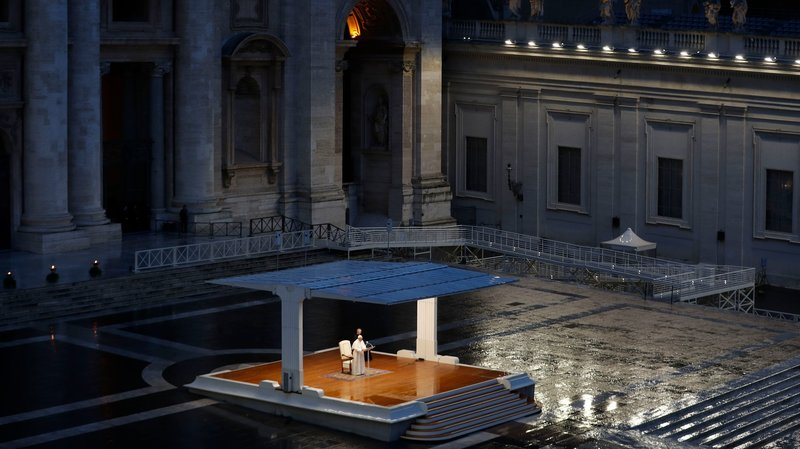 The Pope praying at the Vatican
