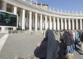 People watching the Pope from outside the Vatican
