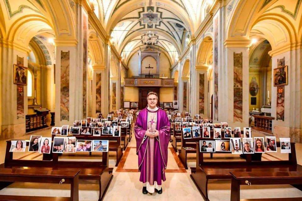 Italian priest with pictures of congregation on the Pew