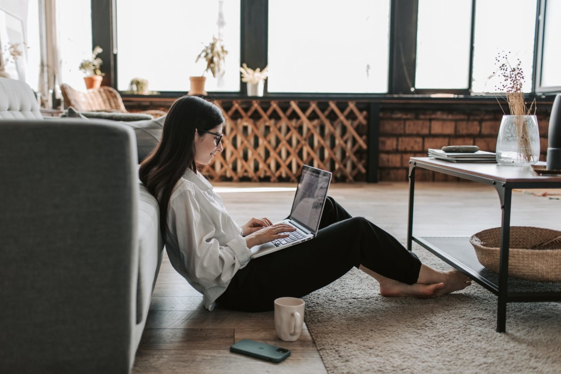 woman working at home with her laptop